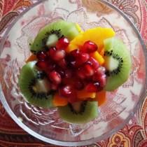 Ataulfo mango topped with kiwi and pomegranate