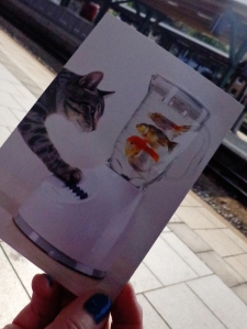 Writing Tiggy's postcard at the train station