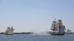 The fireboat salutes the tall ships